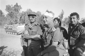 "Defense Minister Moshe Dayan and war hero Arik Sharon, the ""King of Israel"" Wikimedia / The Israel Defense Forces Archive Pikiwiki Israel / https://creativecommons.org/licenses/by/2.5/deed.en"