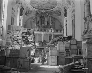 US soldier surveying looted art in a church in Ellingen, 1945 (c) Public Domain